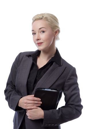 smartly: Close up portrait of a smartly dressed business woman wearing a black blouse and a suit jacket, holding a filofax organiser.  Isolated on white.