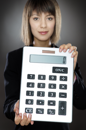 calculator chinese: business woman holding out a large calculator