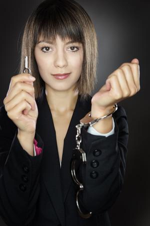 unlocking: woman unlocking herself from handcuffs