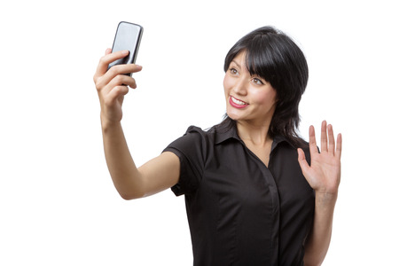 sexy pictures: Studio shot of a business model talking a selfie, isolated on white Stock Photo