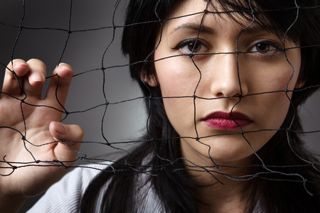 woman behind: Studio shot of a business woman behind a  net