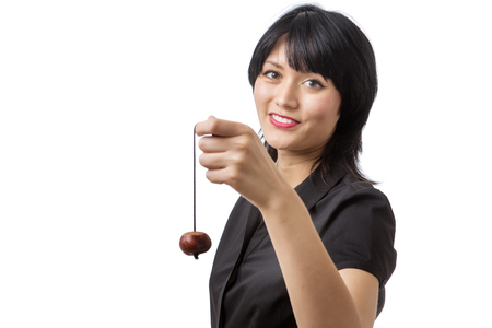 conker: happy business model with a conker on a string held up in front of her.