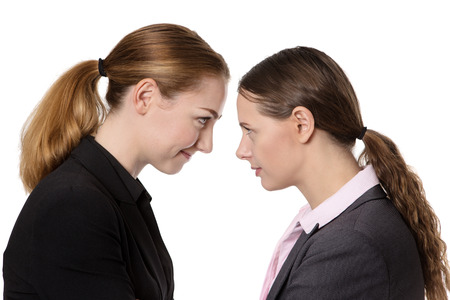 banging: Close up office shot of two businesswomen knocking their heads together.  isolated on white