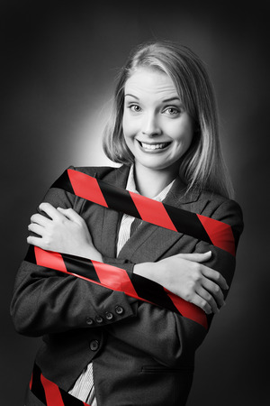 red stripe: Business model is tied up with a black and red stripe tape wound around her. Stock Photo