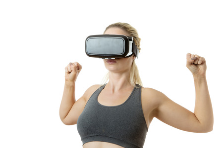 fitness woman wearing virtual reality headset as if she is down the gym Stock Photo