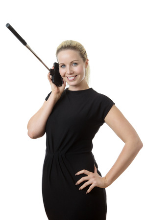 business woman on the phone talking showing you how not to use a selfie stick Stock Photo