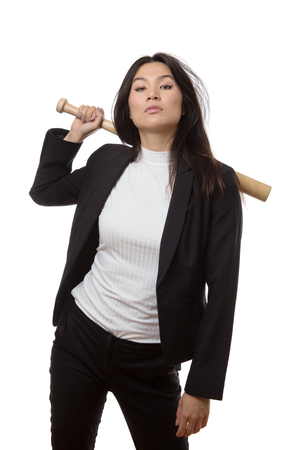 strong base: business woman wielding a base ball bat looking mean and strong
