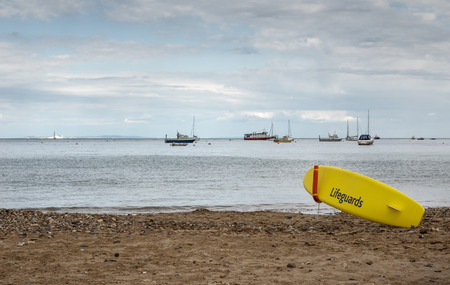 lifeguard surfboard on the beach in swanage bay Stock Photo