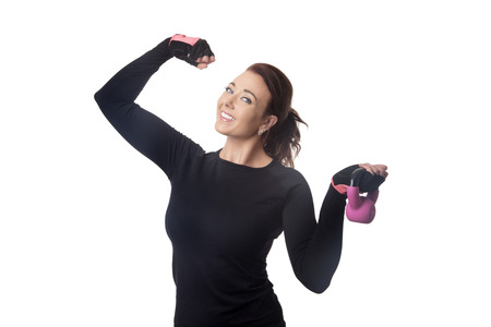happy fitness woman using a kettlebell to work out with Stock Photo