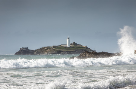 landscape shot of  the light house at Godrevy beach