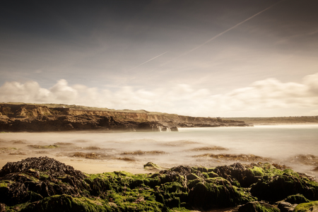 rocky beach in cornwall taken with a long exposure