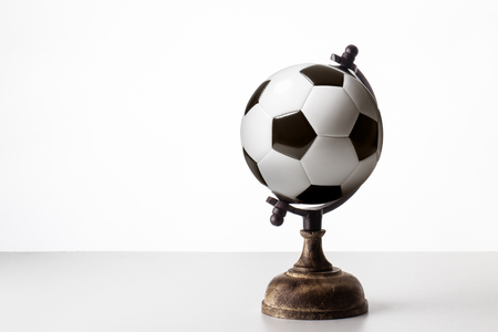 world globe in the shape of a football Stock Photo