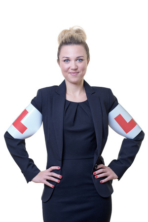 l plate: business woman wearing car L plates on her arms