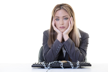 female business woman sitting at her desk locked out of computer