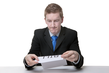 business man holding a paper sign with the word bill written on it looking unhappy photo