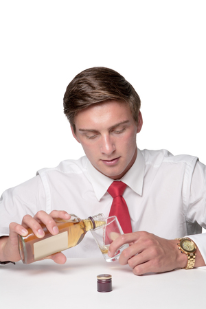 business man drinking alcohol at work sneakily photo