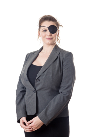 geschäftsfrau tragen eine Augenklappe über einem Auge Standard-Bild