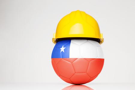 fútbol con un casco con la bandera de Chile superpuesta al fútbol