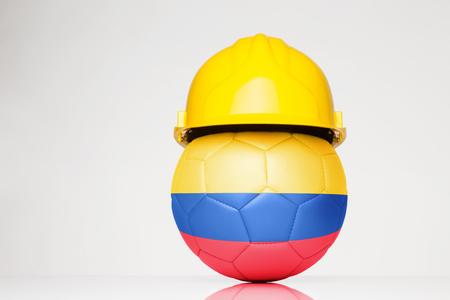 サッカー サッカーの上に重ね、コロンビアの国旗とハード帽子をかぶって