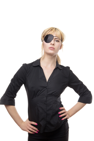 blonde haired business woman in a shirt wearing a eye patch 스톡 콘텐츠
