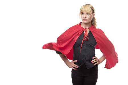 blonde haired business woman wear a superhero cape ready for anything  Stock Photo
