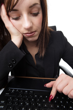 point of view from monitor of youg business woman looking bored at work and unhappy Stock Photo