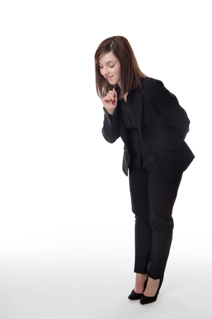standing business woman looking down at something on the ground