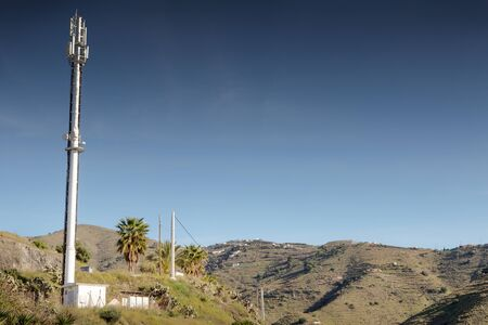 landscape image of mobile phone masts in spain on a hill side