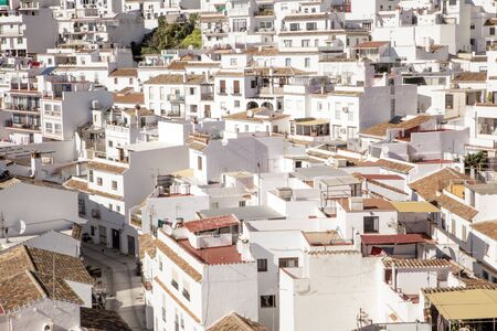 hillside town of mijas with lots of whitewash building and homes build into the hillside