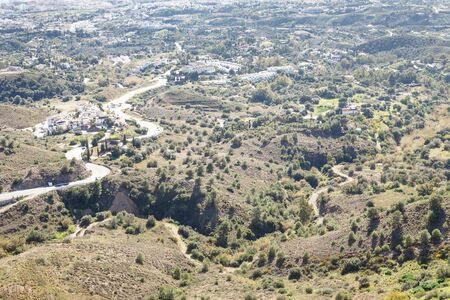 view looking out from the mountin side town of mijas with a road going to Fuengirola town spain