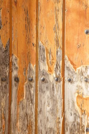close up detail shot of paint peeling on an old wooden door
