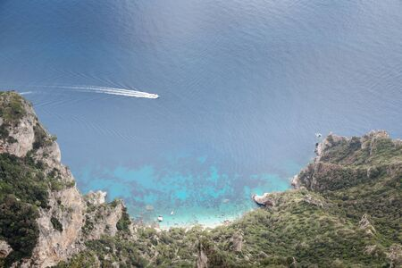 looking down at a bay from  mount solaro the highest point on the island of capri in italy Stock Photo