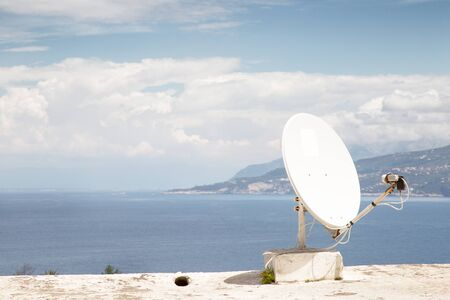 roof top image of a build on the island of capri in italy with a satellite dish on its roof