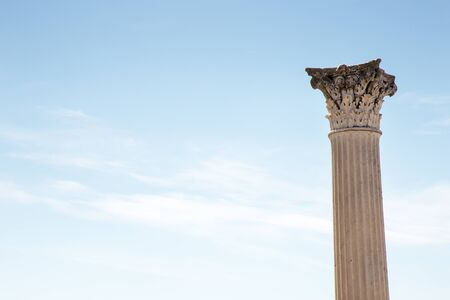 roman column against a blue sky in the city of pompeii