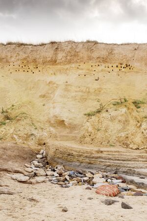 erosion on a cliff face in happisburgh england showing different layers