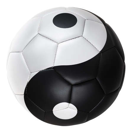Still life image of black and white football with the yin and yang symbol on the football Standard-Bild