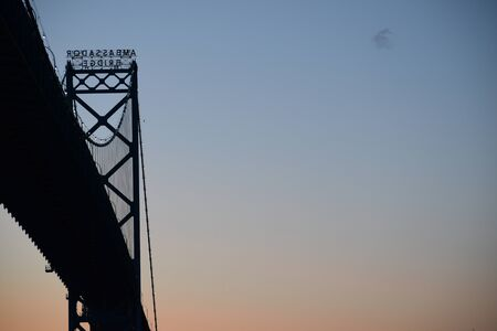 Ambassador bridge view from the bottom at sunset. Detroit Windsor border between USA and Canada. Space for text on the right Banque d'images