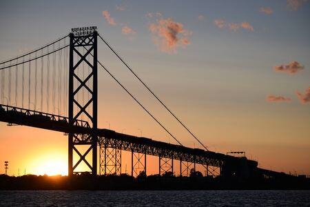 Silhouette of the Ambassador Bridge at sunset. Border bridge between Detroit, Michigan and Windsor, Ontario