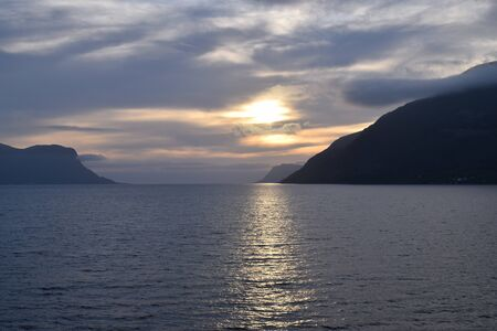 Norwegian fjord at sunset.