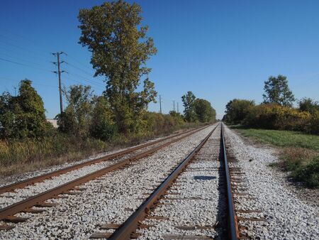 Rusty railroad tracks on a summer day. Remote public transportation. Rural train. Banque d'images