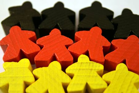 German flag made of black, red and yellow meeples. Euro board game pieces. Strategy games. Banque d'images - 150336438