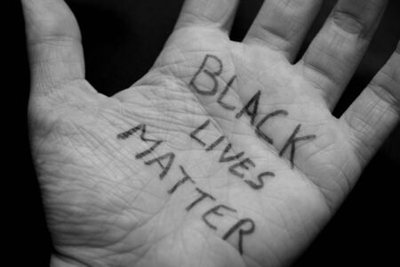 Black and white close up of a palm with the words Black Lives Matter written on it Banque d'images