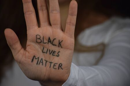 Close up of a white person's palm with the slogan Black Lives Matter on it Banque d'images