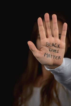 Portrait of Caucasian girl showing support to the Black Lives Matter movement Banque d'images