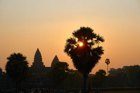 Sunrise view of popular tourist attraction ancient temple complex Angkor Wat in Siem Reap, Cambodia