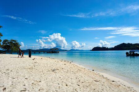 LANGKAWI, MALAYSIA - OCTOBER 15.2019:: Family at beach at island hopping in Langkawi.