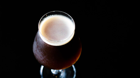 Belgian dubbel beer , dubbel is a belgian  beer. Rich malty ,mild alcoholic ,dark fruit aromas, dark amber color.