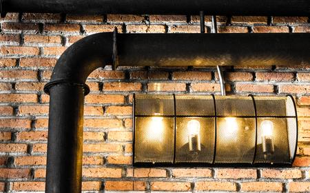 vintage light lamp on red brick Stock Photo