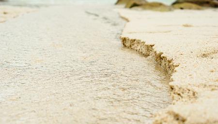sea is eroded sand on the beach at sunset beach lipe island, Thailand Stock Photo