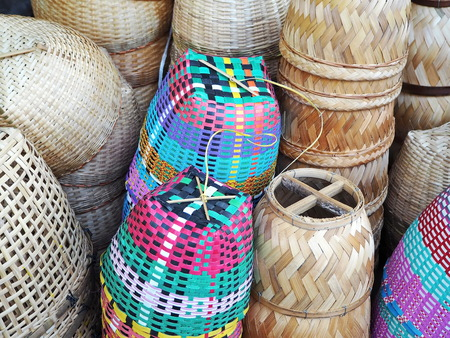 Handmade Asian Bamboo and Plastic Baskets at the Local Market 写真素材